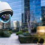 security CCTV camera or surveillance system with buildings on bl